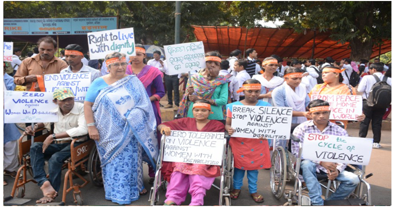 participants with disabilities holding placard